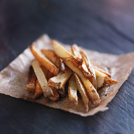 home made potato fries on slate