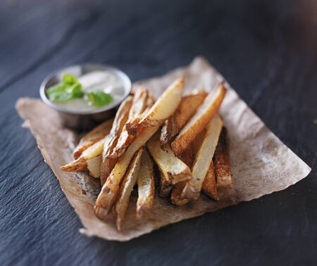 potato fries with mint dip on the side
