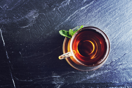 top down: top down photo of a glass of tea on slate Stock Photo