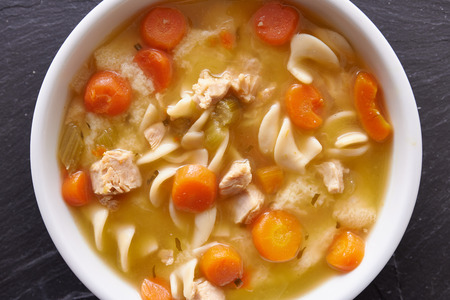 close up food: chicken noodle soup top down photo close up Stock Photo