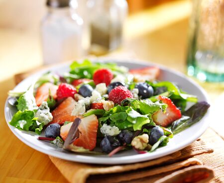berry: berry salad with blue cheese crumbles and walnuts