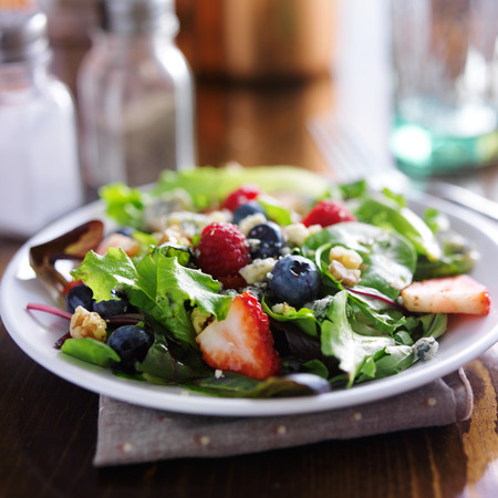 mixed berry salad with walnuts and blue cheese