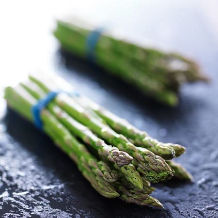 bunched: side view of two bunches of fresh asparagus