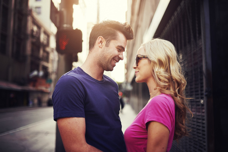 gazing: romantic couple gazing at each other lovingly in down town los angeles Stock Photo