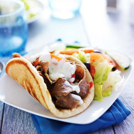 greece: gyro with greek salad and tzatziki sauce