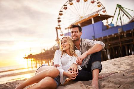 romantic places: happy romantic couple at santa monica during sunset