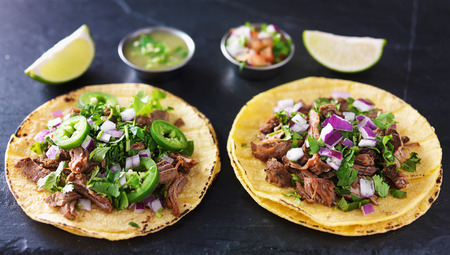street food: two authentic mexican tacos with barbacoa and carnitas Stock Photo
