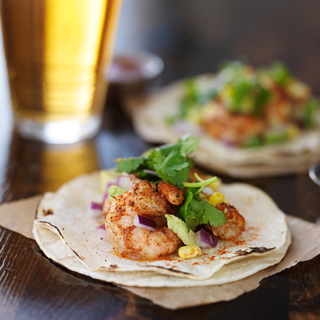 mexican shrimp tacos with avocado and beer