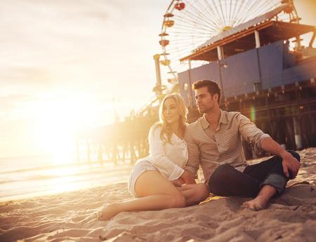 romantic couple enjoying sunset at santa monica
