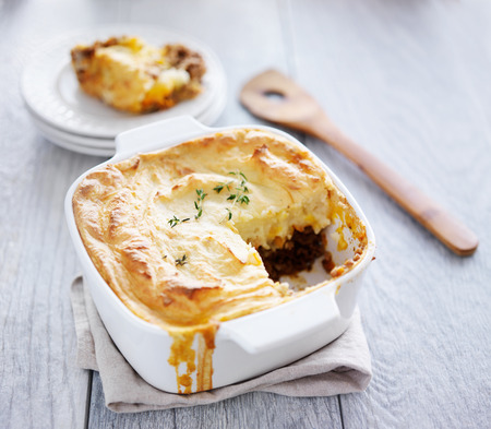 meat dish: cottage pie with piece missing Stock Photo