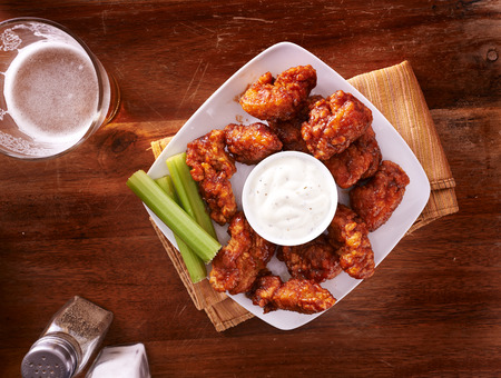 bbq buffalo chicken wings with beer ranch and celery shot top down