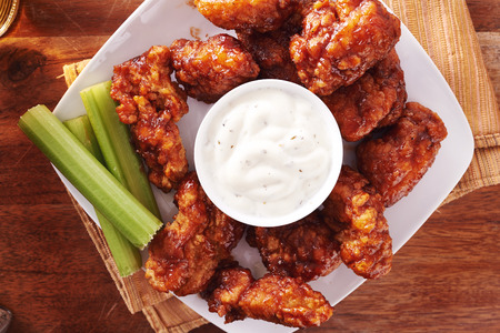 top down: bbq buffalo chicken wings with beer ranch and celery shot top down