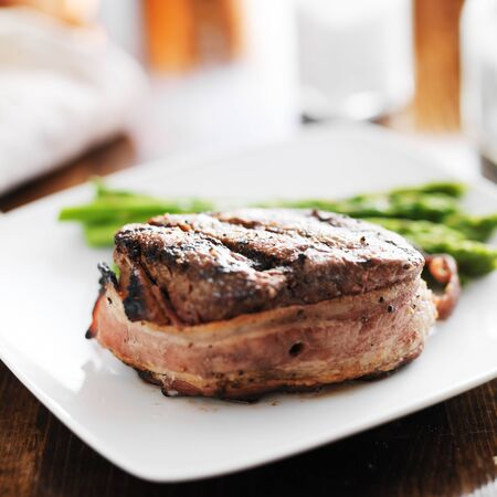 bacon wrapped beef steak filet with asparagus side Reklamní fotografie