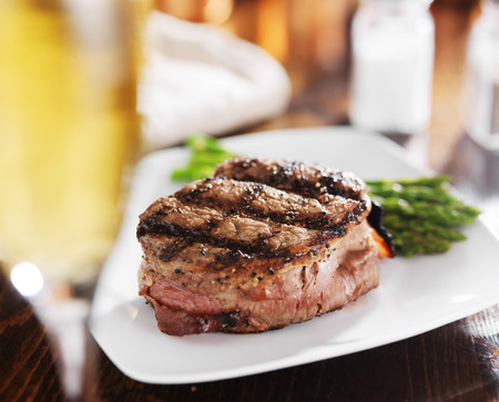 grilled steak filet with white wine and asparagus