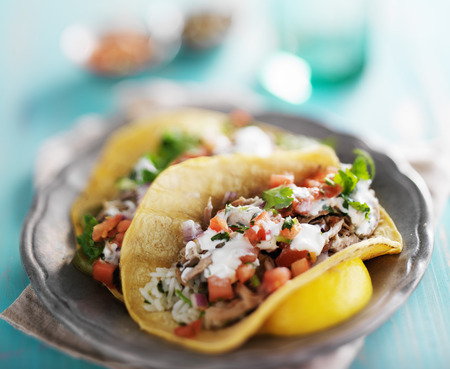 authentic mexican  carnitas tacos with sourcream