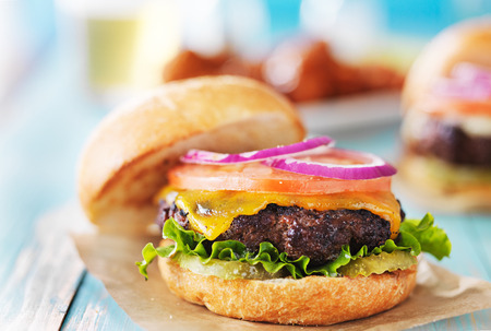 cheeseburger: tasty cheeseburgers with wings and beer Stock Photo