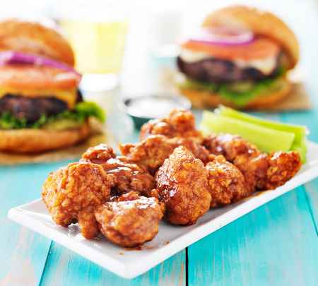 boneless barbecue chicken with burgers and beer