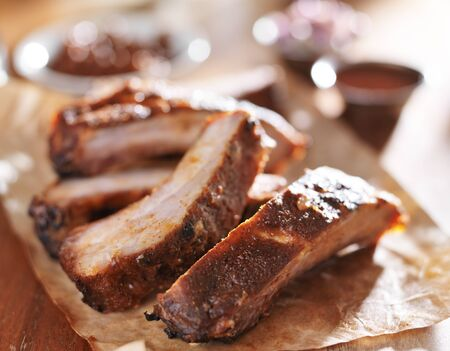 spare ribs: grilled pork spare ribs in barbecue sauce on wooden cutting board Stock Photo