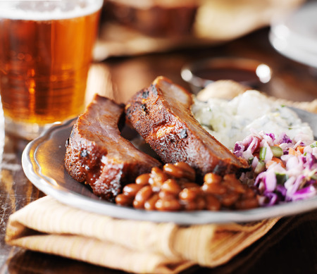 barbecue ribs: barbecue rib meal with fixings