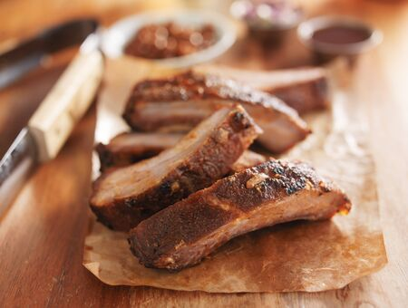 tongs: barbecue pork spare ribs on cutting board with tongs