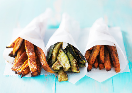 trio of carrot, zucchini, and sweet potato fries shot head on Stockfoto