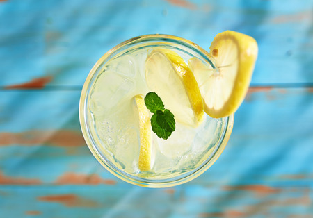 top down: fresh lemonade with mint shot top down on rustic table Stock Photo
