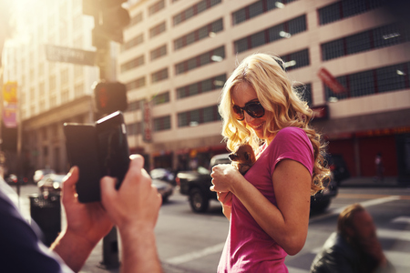 cuteness: taking selfie with teacup chihuahua in los angeles Stock Photo