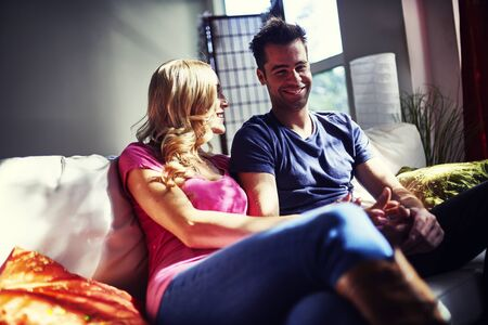 lifestyle caucasian: couple at home on couch having a good time Stock Photo