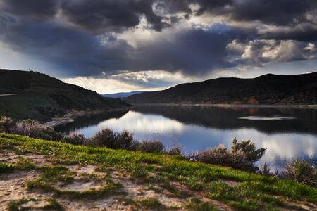 echo: echo reservoir in utah with dramatic clouds Stock Photo