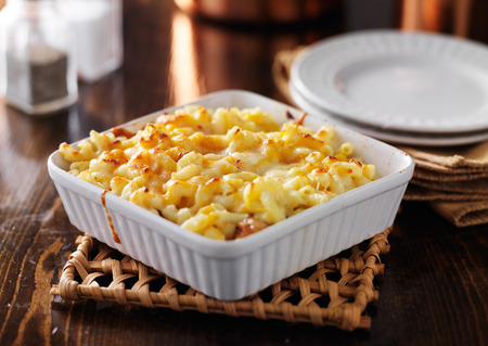 melted cheese: casserole dish with baked macaroni and cheese Stock Photo