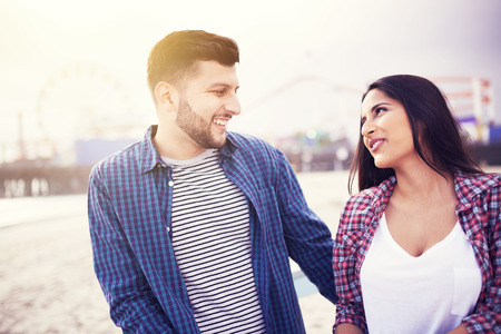 santa monica: fun active hispanic couple in front of santa monica pier Stock Photo