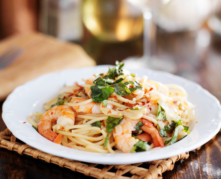 shrimp sicilian pasta with crushed red pepper and chopped basil Stock Photo