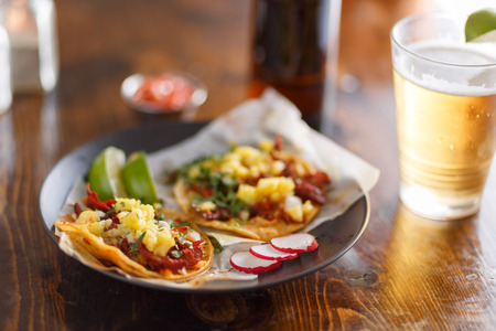 al pastor street tacos with pineapple and beer