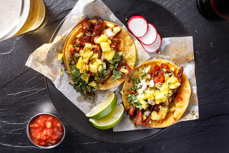street shot: mexican street tacos with beer shot top down