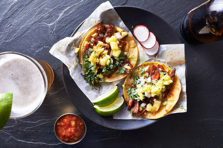street food: mexican street tacos with beer shot top down