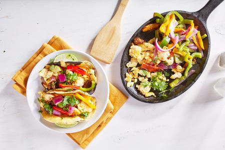 chorizo: chorizo scrambled eggs fajita skillet meal shot from overhead