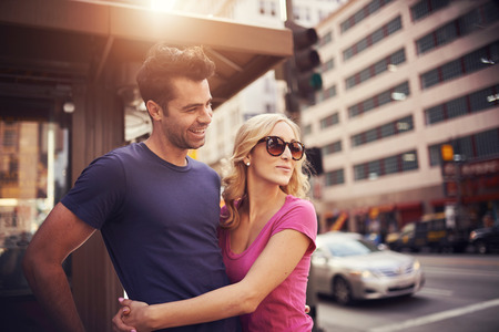 down town: romantic couple on street corner in down town la