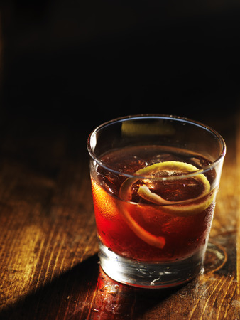 sazerac cocktail on dark wooden background with copy space