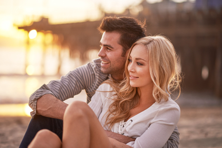 two lovers cuddling by santa monica pier
