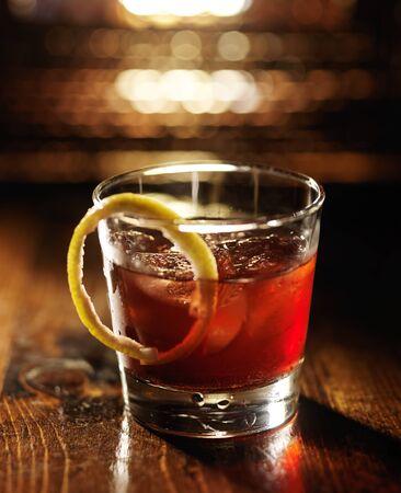 rye: sazerac cocktail on dark wooden background with warm glow Stock Photo