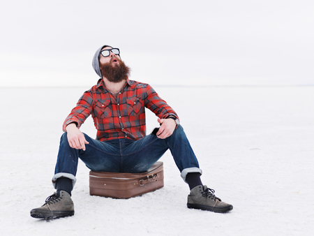 finds: overly happy beard hipster lost in the salt flats finds directions Stock Photo