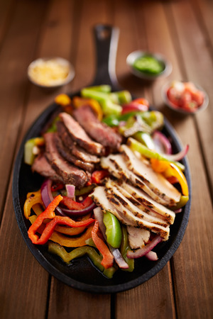 cast iron: mexican steak and chicken fajitas in cast iron skillet