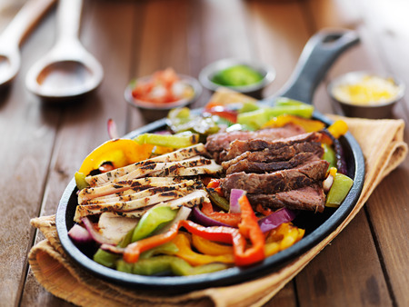 fajita: mexican fajita skillet meal with steak and chicken
