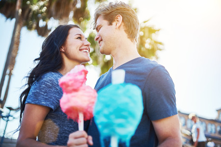 cotton candy: boyfriend and girlfriend on romantic date with cotton candy