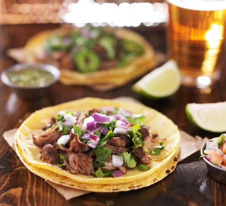 yellow corn: mexican beef barbacoa street tacos on soft yellow corn tortillas