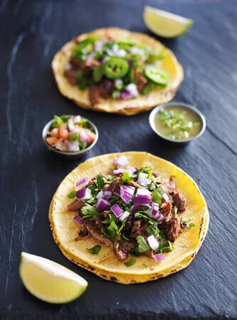 mexican: two authentic mexican street tacos with barbacoa beef