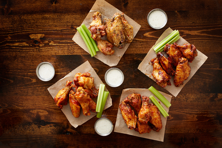 to pdown view of chicken wing party platter made to share with four different flavors and ranch dipping sauce