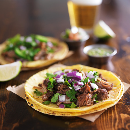 yellow corn: authentic mexican street tacos with barbacoa beef on yellow corn tortilla