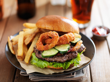 onion rings: big cheeseburger loaded with onion rings, bacon and bbq suace served with fries