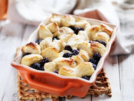 blackberries: blackberries and creamcheese with baked biscuit wedges casserole Stock Photo